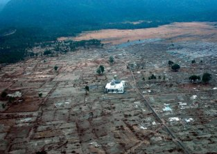 BANDA ACEH, SUMATRA, INDONESIA - JANUARY 4: In this handout image provided by the U.S. Navy, a lone mosque remains standing among the damage of a coastal village January 4, 2005 near Banda Aceh, Sumatra, Indonesia. Helicopters assigned to Carrier Air Wing Two (CVW-2) and U.S. sailors from the USS Abraham Lincoln are conducting humanitarian operations in the wake of the tsunami which struck Southeast Asia December 26, 2004. The Abraham Lincoln Carrier Strike Group is currently operating in the Indian Ocean off the waters of Indonesia and Thailand. (Photo by Jacob J. Kirk/U.S. Navy via Getty Images)